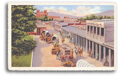 This vintage postcard features the old covered-wagon days in downtown Santa Fe, New Mexico. In the distance you can see the St. Francis Cathedral and the original La Fonda Hotel.